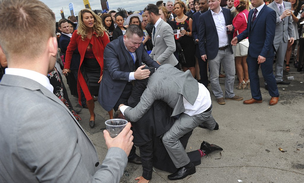 A fight breaks out on Ladies Day of the Grand National Festival 2014 at Aintree