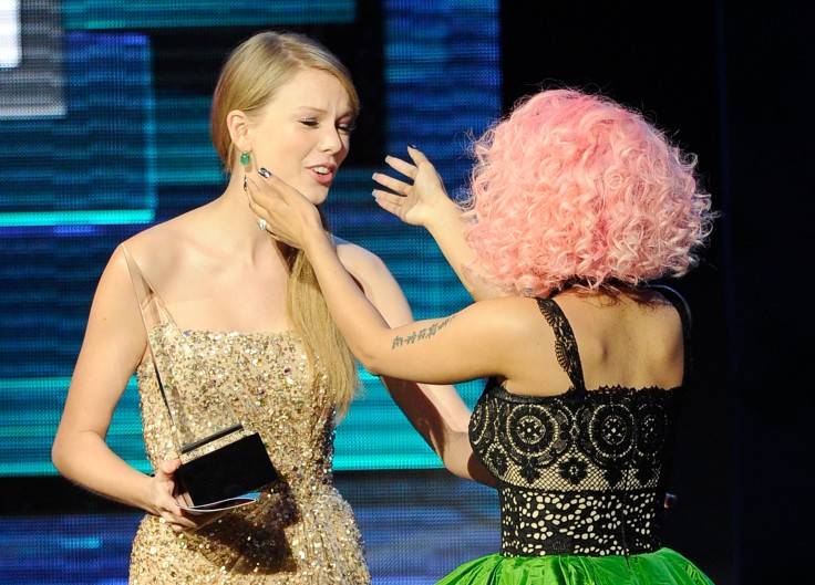 LOS ANGELES, CA - NOVEMBER 20:  Singer Nicki Minaj (R) accepts Rap/Hip-Hop Favorite Album award from singer Taylor Swift onstage at the 2011 American Music Awards held at Nokia Theatre L.A. LIVE on November 20, 2011 in Los Angeles, California.  (Photo by Kevork Djansezian/Getty Images)